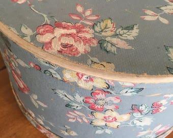 Vintage blue wallpaper floral hatbox storage