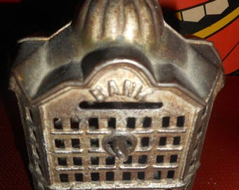 Vintage cast iron, metal dime bank, great condition, heavy complete with key. collectable and awesome.
