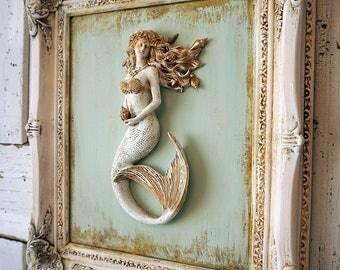 White framed mermaid sculpture wall hanging beach cottage distressed deep vintage frame sea green blue background decor anita spero design