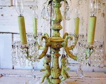 French putti candelabra fancy ornate painted large electric lighting heavy piece w/ crowned cherubs embellished crystal anita spero design