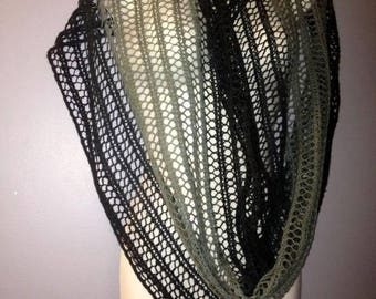 Gray hand - black knitted cable scarf