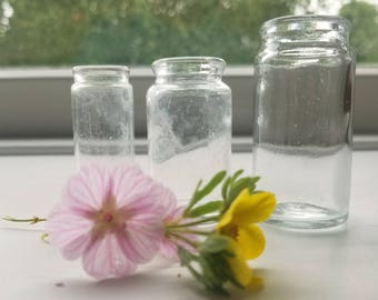 Three Vintage Clear Glass Round Pharmacy Apothecary Medicine Vials Bottles