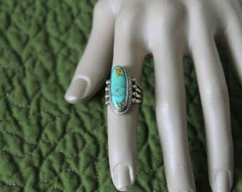 Beautiful turquoise in sterling silver setting.