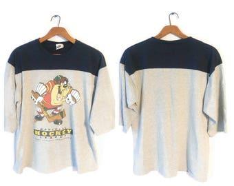 1990s TAZ Tasmanian Devil shirt Size XL Taz Hockey Acme clothing Goalie