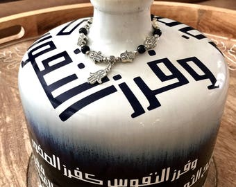 Blue and white vase With arabic calligraphy poetry.