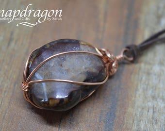 Agate tumblestone with drusy inclusion wrapped in copper