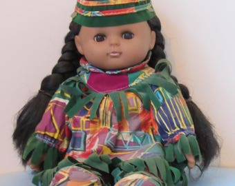 Native American Indian Doll, seated, 8 Inch tall, Eyes open & close