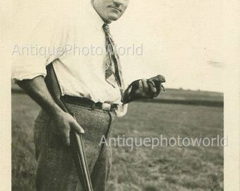 Happy hunter with rifle and dead squirrel antique photo