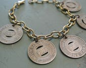 Vintage Charm Bracelet, Bracelet made from Vintages Bus Tokens,Canton Beaumont Ohio and Wisconsin,Repurposed,One of a Kind By UPcycled Works