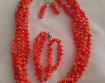Orange coral teardrop beads, 4 strands necklace, 2 strands bracelet and earrings.