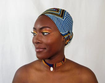 Head tie with cowrie choker