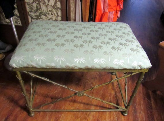 Metal upholstered bench with palm tree fabric cushion