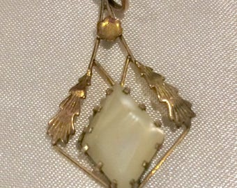 Gold and white stone pendant
