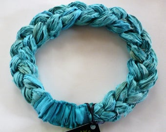 A Sari Silk Braided headband in clear aqua tones as refreshing as a sea breeze! Soft and comfortable and adjustable.