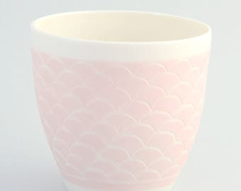 Cup made of porcelain in pink