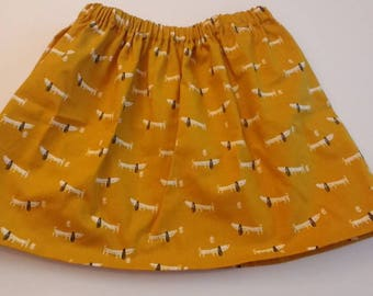 Girls mustard yellow skirt with doggies