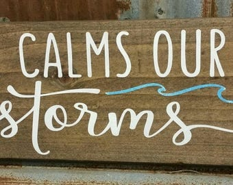 He Calms Our Storms sign