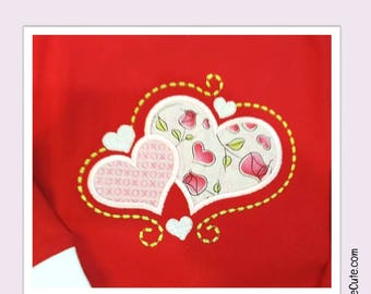Embroidered Valentine Pajamas with cute Hearts design.  Personalization available.