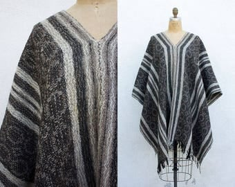 1970s Woven South American Ethnic Striped Fringe Poncho | Wool Blanket Poncho | Native American Shawl Wrap | Black + Tan Mexican Poncho