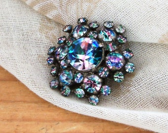 Gorgeous vintage rainbow rhinestone brooch with silver coloured metal and diamante floral design