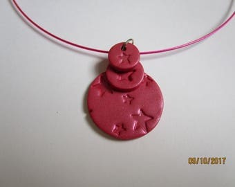 Pink statement necklace with star pattern.