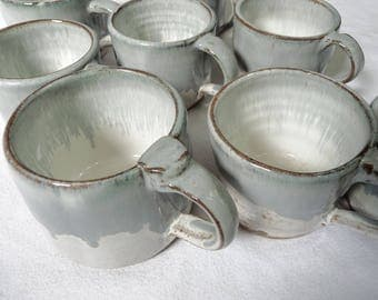 Set of Seven Blue and White Mugs