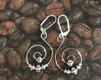 Silver swirl earrings with Tibetian beads