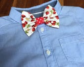 Summer strawberry bow tie for baby boys age 12 months to 5 years in cotton fabric with red lining and middle and hook and eye tape fastening