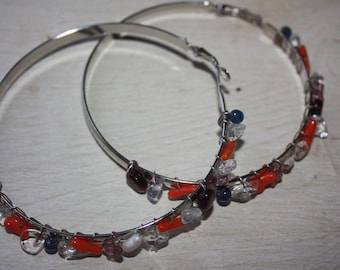 Silver plated hoops adorned with stones