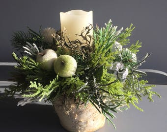 Faux christmas candle arrangement in whites and greens. Christmas centrepiece. Floral arrangement