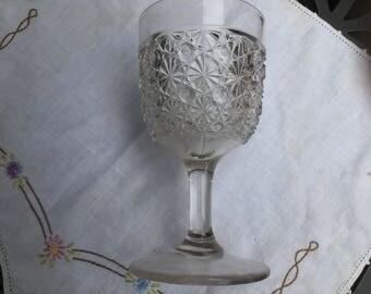 Pressed glass goblet - starburst pattern