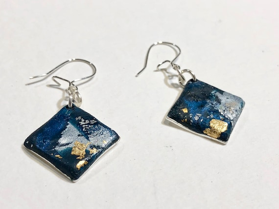 Earrings - contemporary blue handmade polymer clay on diamond shaped silver plated piece with sterling silver ear wire