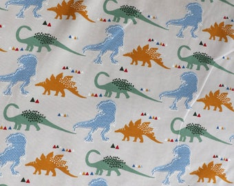Fabric - cotton/elastane medium weight jersey fabric - cream dinosaur print - knit fabric.