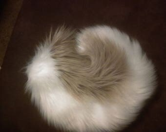 Sand and White Husky Tail