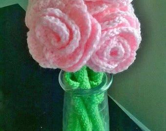 A dozen crocheted roses