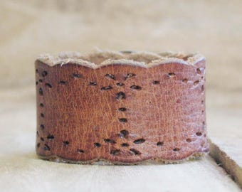 CUSTOM HANDSTAMPED scalloped distressed brown leather cuff with design by mothercuffer