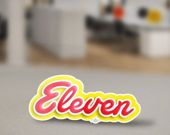 Eleven Eggo Sticker Design from the Stranger Things Universe Inspired from the Eggo Waffle font for Eleven's love for waffles. Upside down.