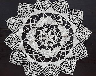 Beige vintage bobbin lace doily
