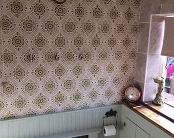 One sealed roll of 1960's Crown wallpaper with a green and gold retro pattern