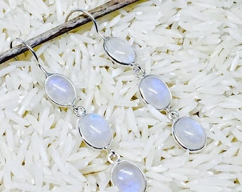 10% Rainbow moonstone earrings set in Sterling silver 92.5.. Length- 1.5 inch long. Perfectly matched natural moonstones.