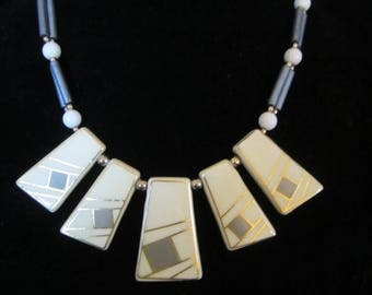 Retro Art-Deco Bib Necklace - Bakelite made in Japan. Tapered centerpiece with two matching smaller pieces on each side. Has that Boho look!