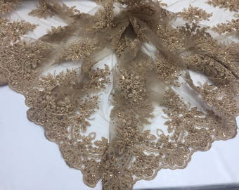 Uniquely designed beaded flower mesh Fabric bridal wedding taupe. Sold By Yard