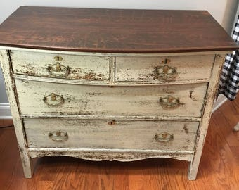 Anique Serpentine Chest of drawers/dresser in chippy milk paint