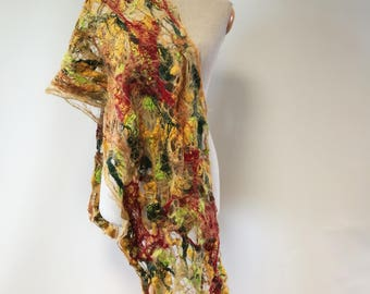 The hot price. Artsy handmade shawl.  Perfect for gift.