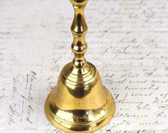 Small brass vintage metal hand bell.