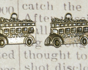 """""""NYC"""" 2 double decker bus charms bronze 23x17mm"""