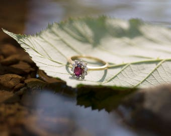 Vintage Style Oval Ruby Ring in Yellow Gold with Halo of Single Cut Diamonds