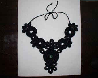 crochet necklace in shiny black cotton with green bead