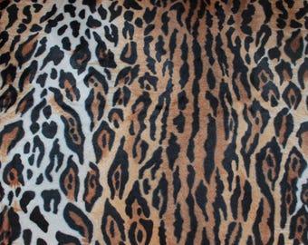 Fausse fourrure guépard noir,marron et blanc: 50 cm x 150 cm