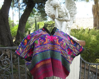 "Traditional Guatemalan blouse ""huipil"" froom Santiago Atitlan.  31 x 39 inches.  Loom woven blue and magenta huipil with hand embroidery."